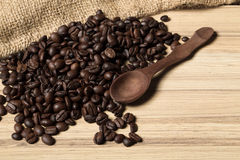 Pile of fresh and bio aromatic coffee beans and spoon Royalty Free Stock Photos