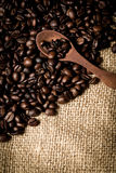 Pile of fresh and bio aromatic coffee beans and spoon Royalty Free Stock Photography