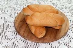 Pile of fresh bun rolls pastry on the wooden board Stock Photography