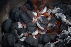 Charcoal starting to burn in home grill stock photography