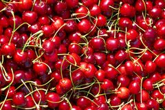 Pile of fresh cherries. A closeup view of a pile of ripe, freshly picked, red cherries Stock Photography