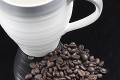 A Pile of Fresh Coffee Beans and a Cup.  Royalty Free Stock Photography