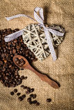 Pile of fresh coffee beans, heart and spoon Stock Image