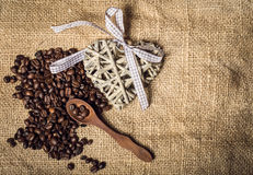 Pile of fresh coffee beans, heart and spoon Stock Images
