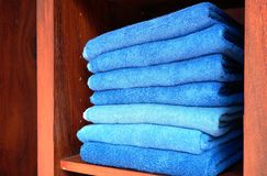 Pile of fresh folded blue bath towels Royalty Free Stock Images