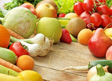 Pile of fresh fruits and vegetables. On a table royalty free stock photos