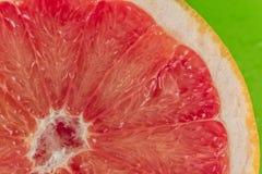 Pile of fresh grapefruits on display at street market royalty free stock image