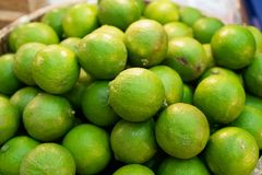 Pile of Fresh green lemon lime for sale in the market.  stock photo