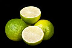 Pile of fresh limes across black Royalty Free Stock Photography