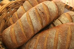 Pile of Fresh Made Whole Wheat Bread Loaves in a Basket stock photos
