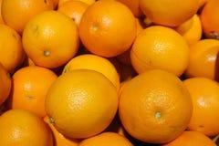 Orange oranges in  supermarket. A pile fresh oranges  under sunlight royalty free stock photos
