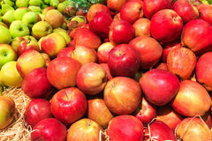 Pile of fresh organic red apples  on a market close up Royalty Free Stock Photos