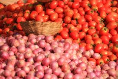 Pile of fresh organic red tomato and onion Royalty Free Stock Image