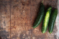 A pile of fresh picked cucumbers on wooden background.  Royalty Free Stock Image