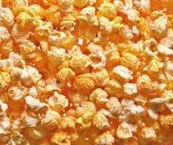 Pile of fresh popcorn filling the frame against bright light Stock Photos