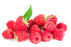 A pile of fresh raspberries. Isolated on a white background Stock Image