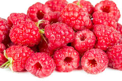 A pile of fresh raspberries. Isolated on a white background Royalty Free Stock Photos