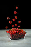 Pile of fresh raspberry and red currant. On wooden background Royalty Free Stock Photo