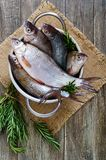 A pile of fresh raw fish on a wooden background. Top view. Carp. Fresh catch Royalty Free Stock Photos