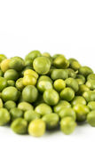 Pile of fresh raw green peas  over white background with copy space.  Stock Image