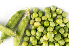 Pile of fresh raw green peas  over white background with copy space.  Stock Photo