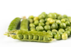 Pile of fresh raw green peas  over white background with copy space Stock Images
