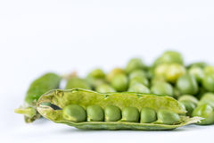 Pile of fresh raw green peas  over white background with copy space Royalty Free Stock Photography