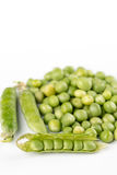 Pile of fresh raw green peas  over white background with copy space.  Stock Photos