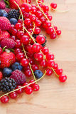 Pile of fresh red berries on table. Pile of fresh red currunt berries on wooden table Stock Images