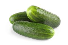 Pile of fresh salted gherkins, isolated Stock Photography