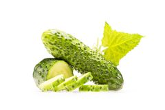 Pile of fresh sliced cucmbers. And green leaf isolated on white Royalty Free Stock Image