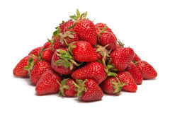 A pile of fresh strawberries. Isolated on white background Stock Photos