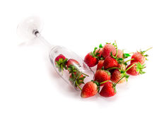 Pile of Fresh Strawberry and Tall Glass. Fresh Strawberry and tall glass , Little shadow  on white ground Royalty Free Stock Photography
