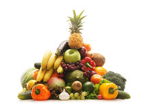 A pile of fresh and tasty fruits and vegetables. A huge pile of fresh and tasty fruits and vegetables. The image is taken in a studio, isolated on a white Stock Photo