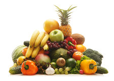 A pile of fresh and tasty fruits and vegetables. A huge pile of fresh and tasty fruits and vegetables. The image is taken in a studio, isolated on a white Royalty Free Stock Photos