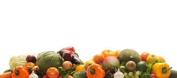 A pile of fresh and tasty fruits and vegetables. A huge pile of fresh and tasty green and orange fruits and vegetables. The image is isolated on a white Stock Photography