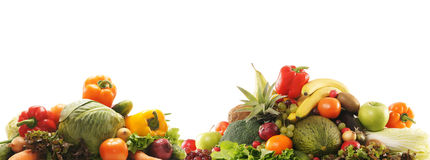A pile of fresh and tasty fruits and vegetables. A huge pile of fresh and tasty green and orange fruits and vegetables. The image is isolated on a white Royalty Free Stock Photo