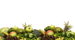 A pile of fresh and tasty fruits and vegetables. A huge pile of fresh and tasty green fruits and vegetables. The image is isolated on a white background Royalty Free Stock Photo