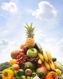 Pile of fresh and tasty fruits and vegetables. The image is taken over the sky background Stock Photography