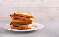 Pile of fresh toasts on plate Stock Photos