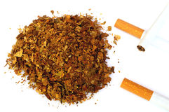 Pile of fresh tobacco and cigarettes isolated on white Stock Photography