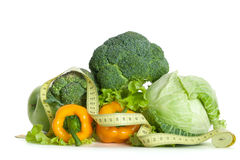 Pile of fresh vegetables with measuring tape Royalty Free Stock Photography