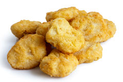 Pile of frozen battered chicken nuggets uncooked and isolated on Royalty Free Stock Image