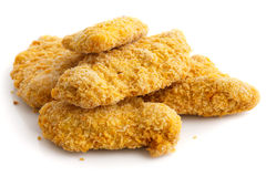 Pile of frozen bread crumbed chicken strips Royalty Free Stock Image