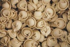 Pile of frozen ravioli or dumplings, supermarket shopping royalty free stock photo