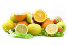 A pile of fruit. Many types of fruit together, and some cut Stock Photo
