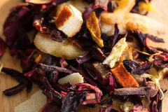 Pile of fruit tea with petals and dry fruit .The composition of the heap of tea leaves and dried hibiscus flower located on a wood Stock Photography