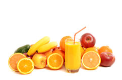 Pile of fruits and a glass of fresh orange juice. Royalty Free Stock Photo