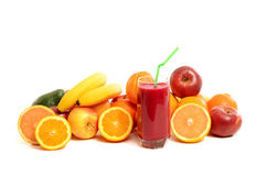 Pile of fruits and a glass of fresh red juice. Royalty Free Stock Images