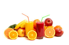 Pile of fruits and two glasses of fresh juice. Royalty Free Stock Photography